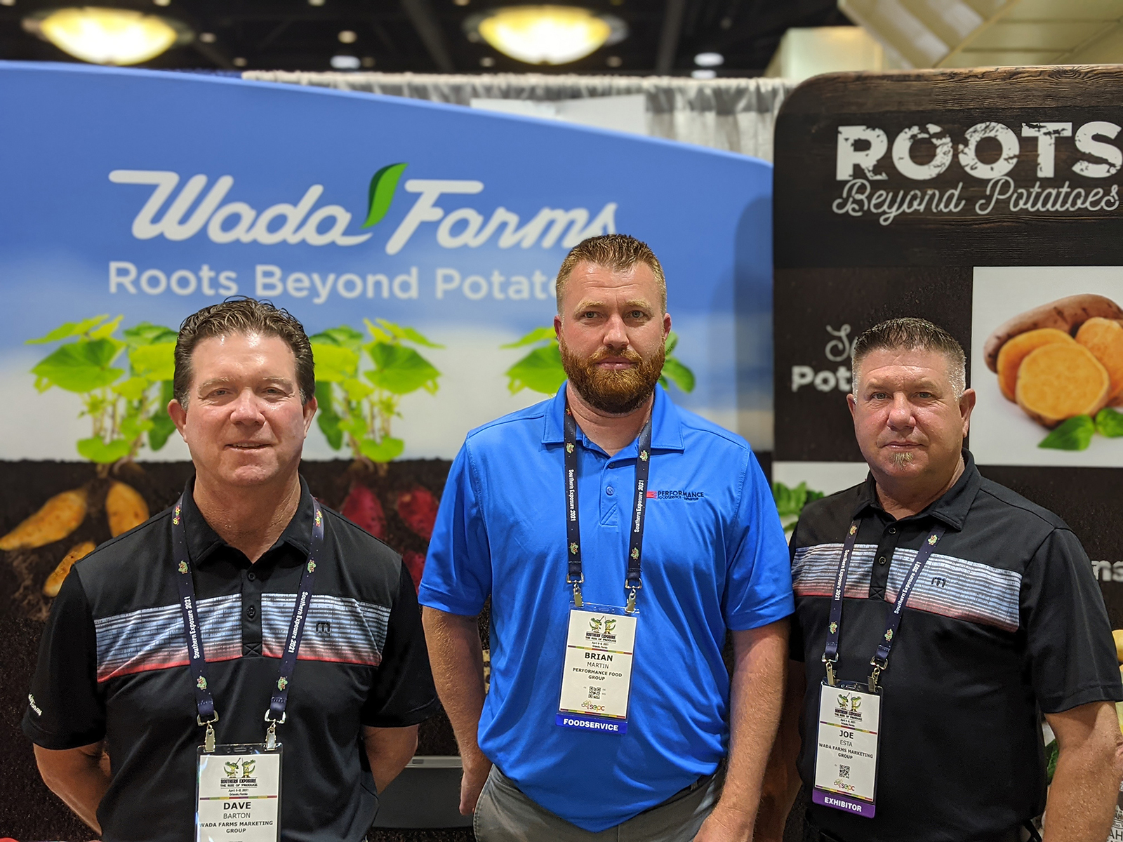 Brian Martin of Performance Food Group flanked by Dave Barton and Joe Esta of Wada Farms.