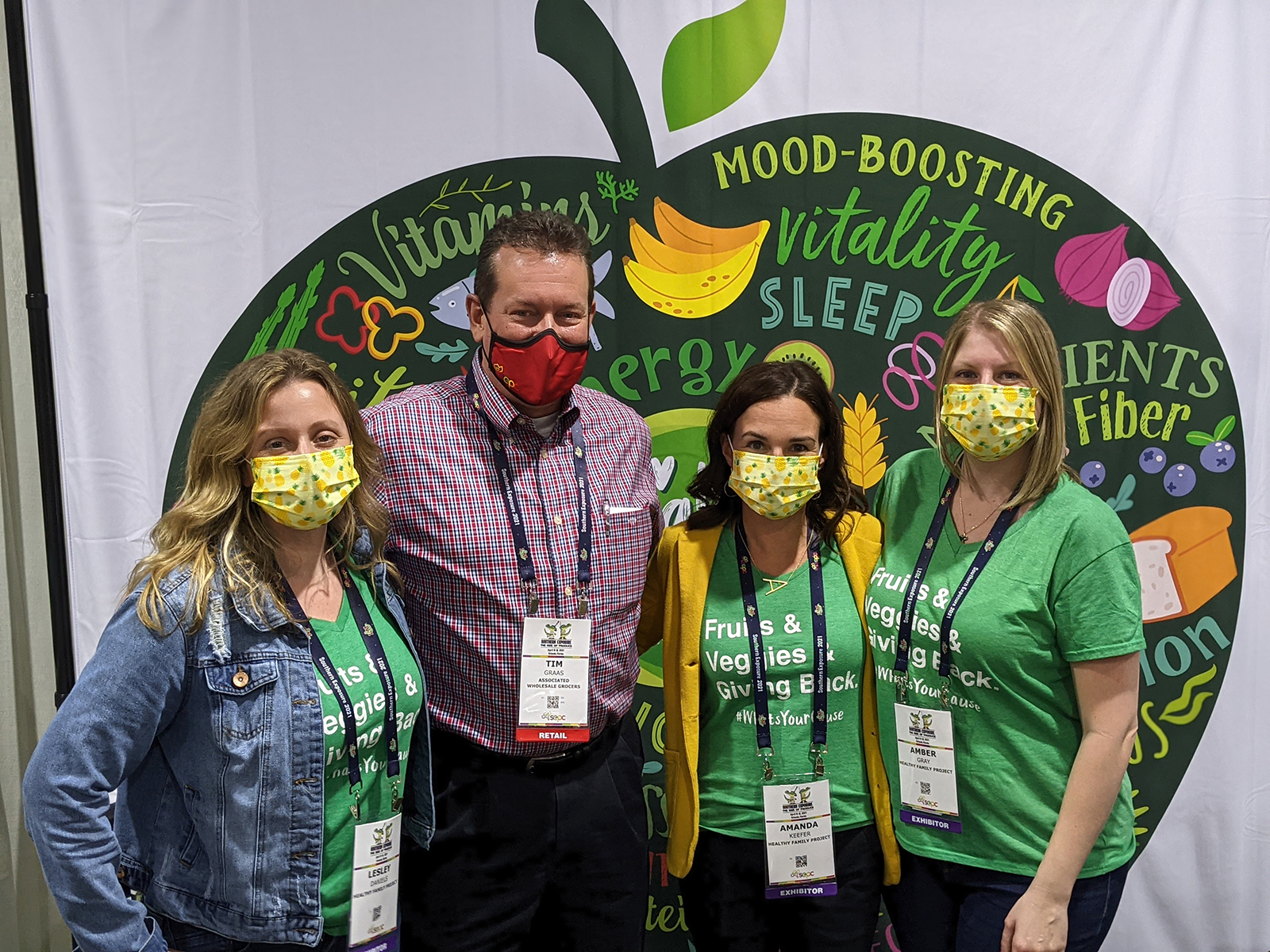Tim Graas of Associated Wholesale Grocers flanked by Lesley Daniels, Amanda Keefer and Amber Gray of Healthy Family Project.