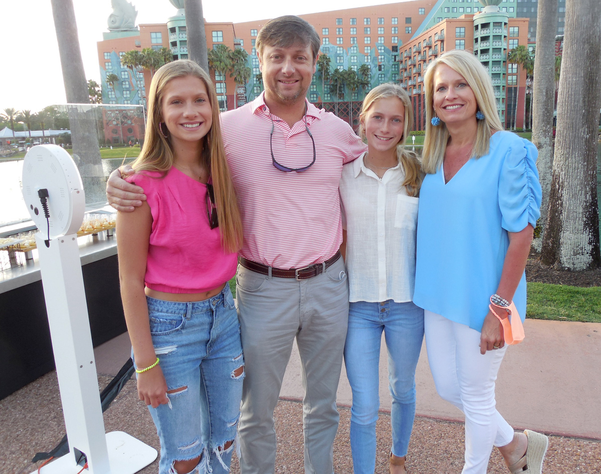 Brandon Parker of Shuman Farms and Natalie Parker, with their daughters Matti, 15, and Mimi, 13.