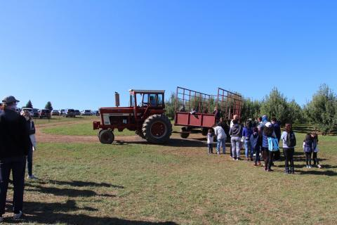 Attendees of the sixth annual Joe DeLorenzo Family Apple Picking Day board a tractor bound for the apple orchards at Melick's Cider Mill and Orchard in Oldwick, NJ.