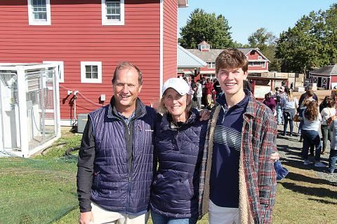 Susan McAleavey Sarlund, executive director of the Eastern Produce Council, with husband Chas and son Charlie at the sixth annual Joe DeLorenzo Family Apple Picking Day Oct. 3 in Oldwick, NJ.