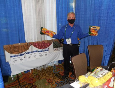 Mike Gianatti of MamaMia Produce displays some product.