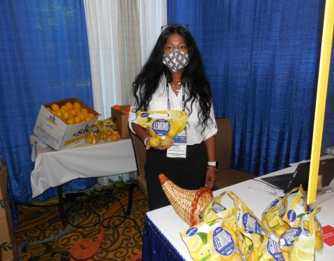 Milly McDougal of Bozzuto's Inc. at the Sunkist booth.