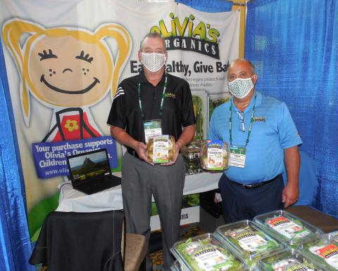 Ken Reagan and Kevin Keough of State Garden/Olivia's Organics display some product.