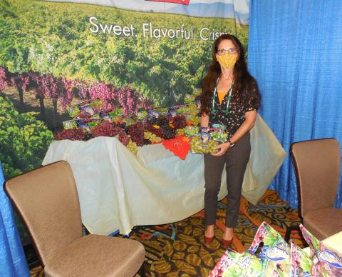 Cheryl Gray of Pretty Lady Sunlight International with some green seedless grapes.