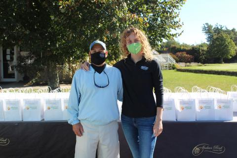 Ron Palermo of Baldor with Lauren Mordasky of RPE Spuds and an NEPC golf committee member.