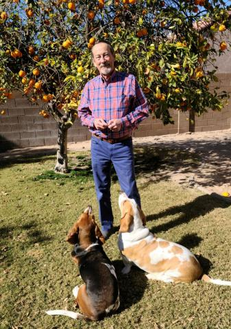 BlueSkySearch's Mike Lovelace picks oranges with Murphy and Gracie.