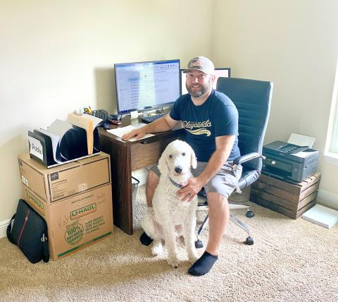 Ian Poteet, a logistics manager with John Greene Logistics Co., with his labradoodle Cash.