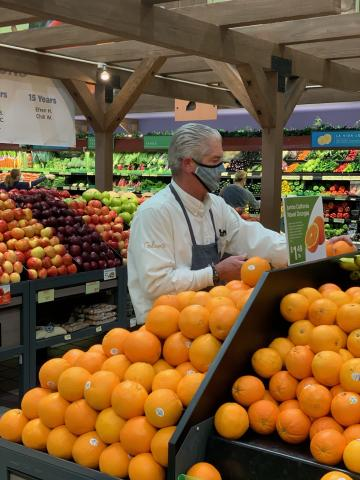 John Parr looking over the citrus in the Gelson's Calabasas store.