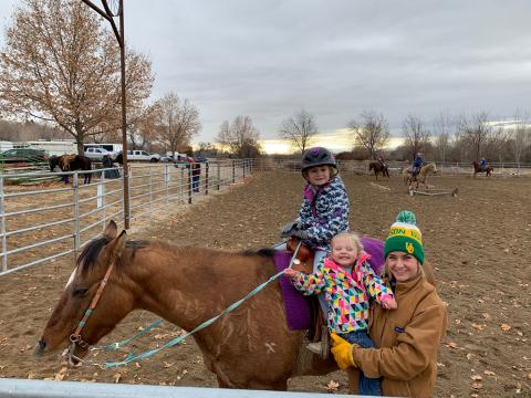 Tiffany Cruickshank of Snake River Produce with daughters MacKenzie (on Lucky Star) and Violet (in arms).