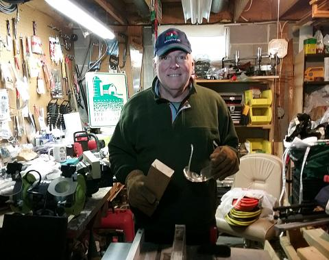 Al Murray of the New Jersey Agricultural Society tinkering in his basement woodshop.
