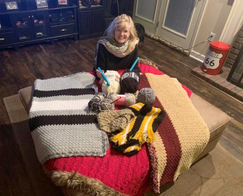 Teri Miller of The Fresh Market, creates wraps, scarves, hats and blankets for children from low-income families to give as Christmas presents to their parents.